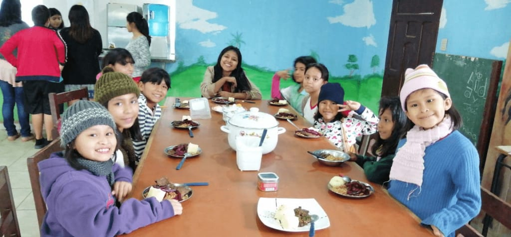 Kind enjoy a nutritious meal at Haven of Hope Bolivia COVID-19 update
